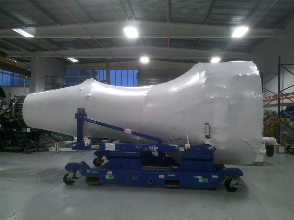 Jet engine wrapped for storage and transport. Gallery Image