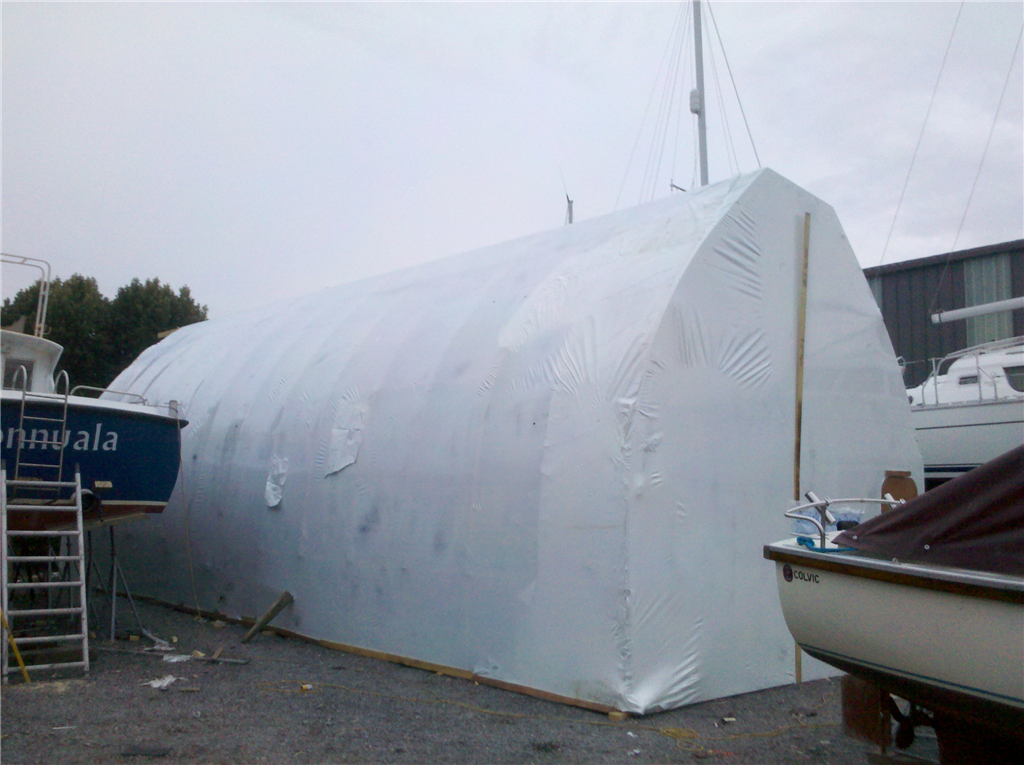Bow roof shed as a temporary workshelter for renovation a boat in Valentia Island. We built the bow roof shed as well! Gallery Image