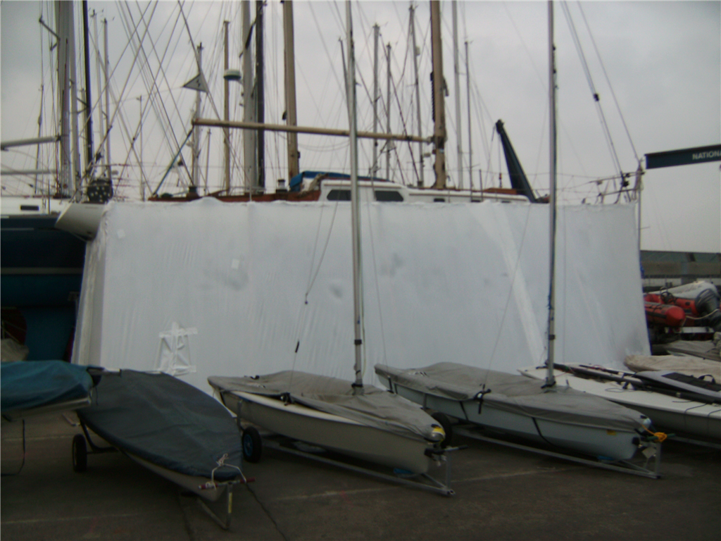Boat hull enclosed for hull repairs. Gallery Image