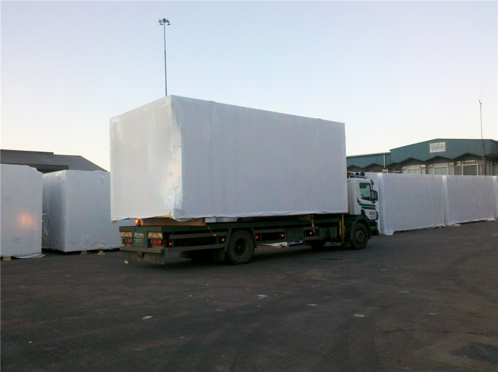 Prefabricated hotel bedrooms wrapping in Warrenpoint waiting for the ship to take them to the Scottish Isles. Gallery Image