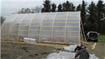 Bow roof shed covered with clear shrink film for use as a greenhouse. We make the bow roof sheds as well! Gallery Thumbnail