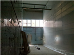 Temporary wall prior to the demolition of the end wall of the production facility. Gallery Thumbnail