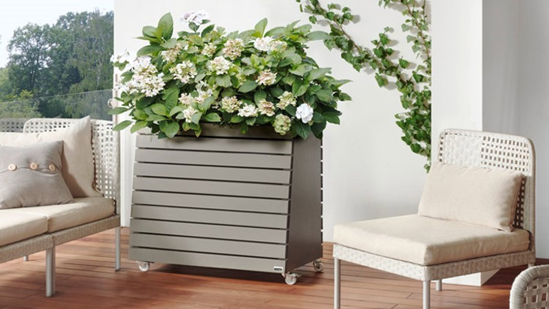 GreenBox planter is an ideal way to add style to a balcony or patio. The bottom section discretely stores cushions or gardening equipment - visit www.gardenfx.ie for more information.    Gallery Image