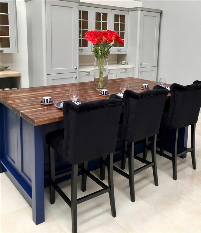 Kitchen Island in custom painted cobalt blue ash doors with a luxurious solid Walnut worktop. Gallery Image