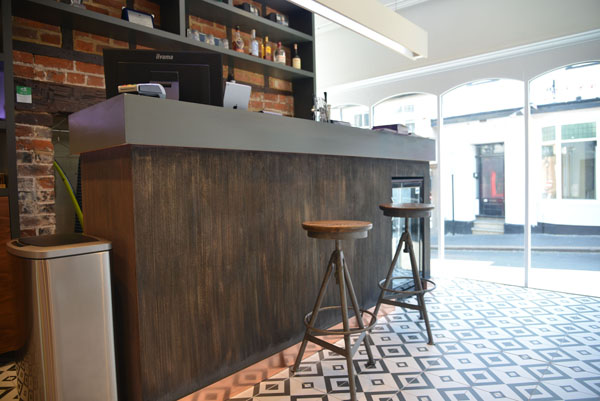 Reception desk done to match this salon's feature walls Gallery Image