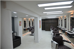 Feature walls and microcement flooring done for this salon Gallery Thumbnail