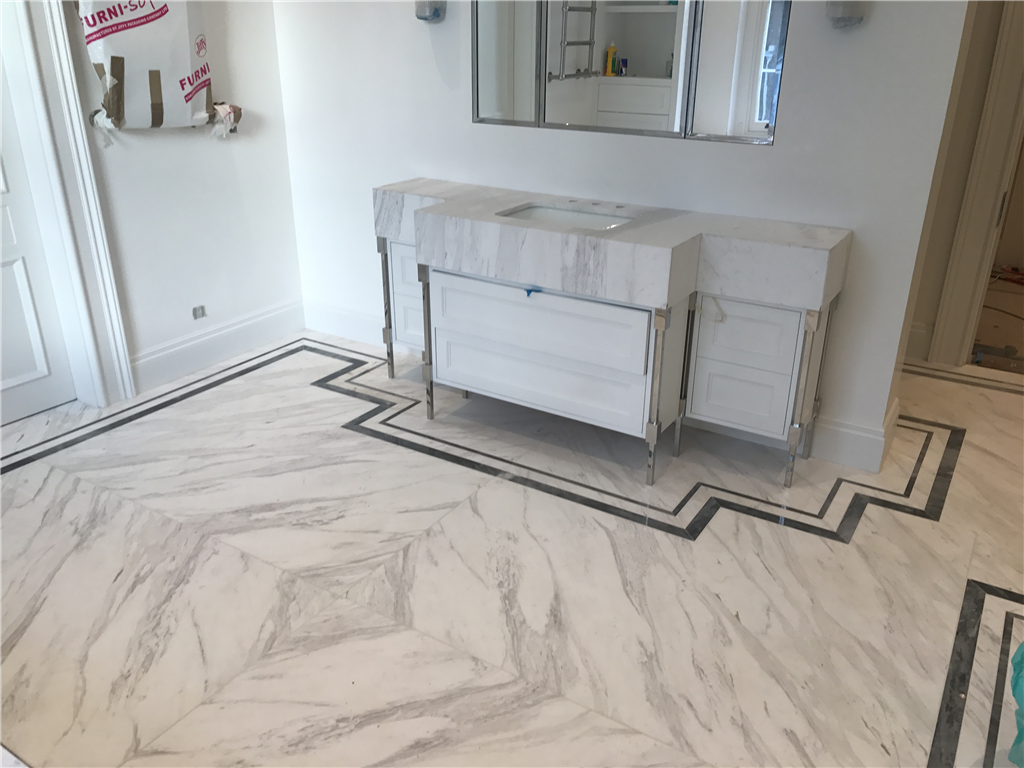 Ariston bookmatched marble floor with Bardilio marble borders, London. Gallery Image