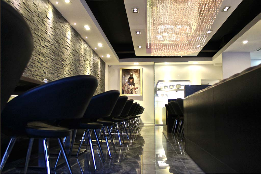 Azul Lagoa polished marble tiles & Nero CadFX wall cladding, The Kitchen restaurant, Middlesex. Gallery Image