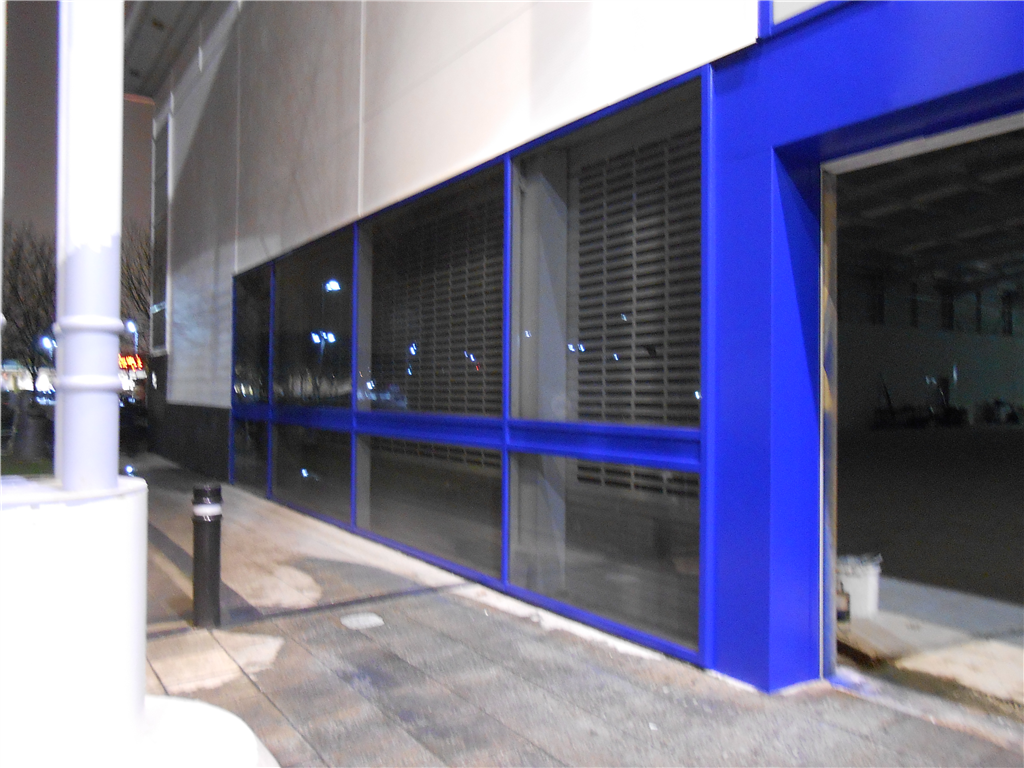 Aluminium window frames and doors spray painted to suit new colour scheme client requested. Gallery Image